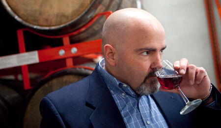 Michael Fairbrother, Moonlight Meadery founder and head meadmaker, sips from a glass.