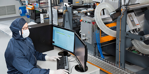 Worker at a desk at Nanocomp